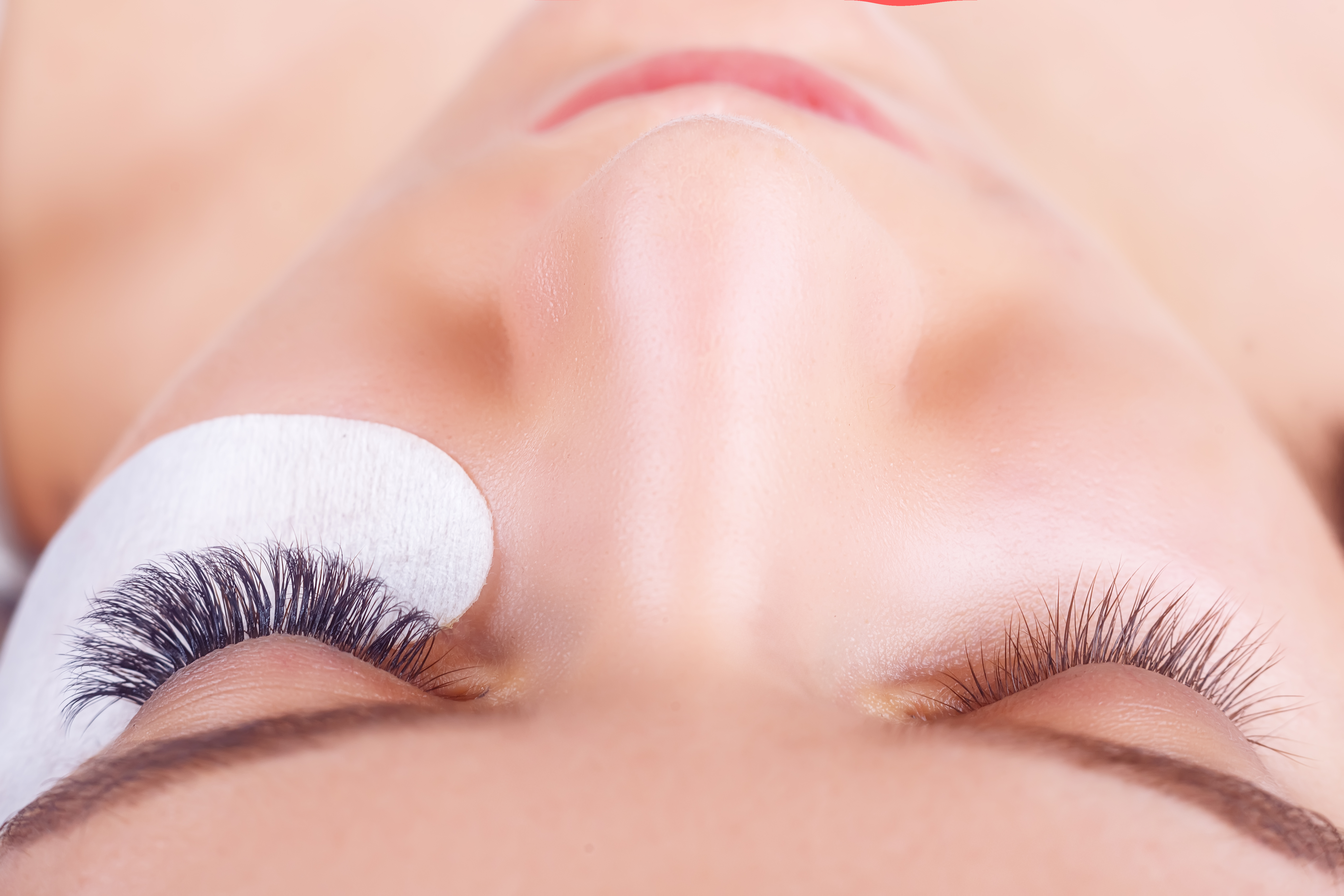 woman during salon service for eyelash extensions in Seattle